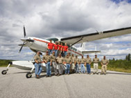 Our staff with Amphibious Cessna Caravan